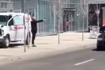 A man confronts police in Toronto after a van ran into pedestrians, killing several.