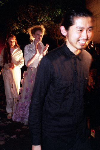 "Isogawa with a ""bridal"" couple at a parade in Sydney, 2000."