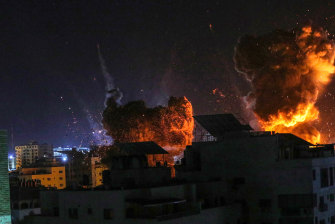 Israeli planes strike a government building in Gaza City on May 18.