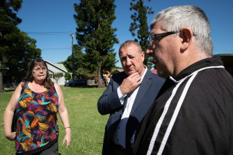 Labor's candidate for the Upper Hunter, Jeff Drayton, centre, talks with Sarah Johnstone and her brother Stuart in Singleton.