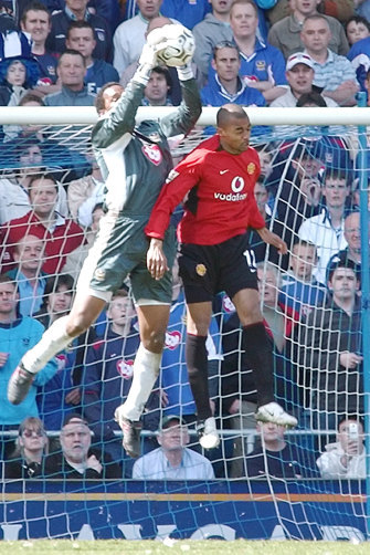 Shaka Hislop, left, takes the ball during a 2004 game between Portsmouth and Manchester United.