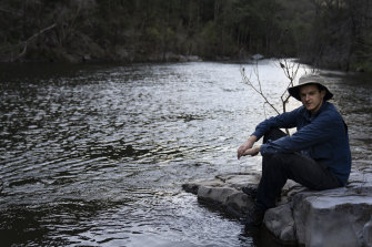 Harry Burkitt, who has led the campaign against the Warragamba Dam wall raising, sits by the Kowmung River which will be partly submerged if the project proceeds.