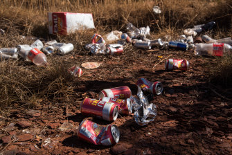 Empty cans and goon bags litter the suburb of East Newman. According to the Shire of East Pilbara, 90 per cent of domestic violence incidents are alcohol-related.