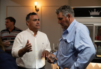 Deputy Premier John Barilaro discusses coal mining with Doug Robertson (right), a farmer and president of the Friends of the Upper Hunter group.
