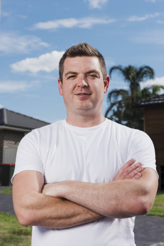 Investor Nathan Birch outside two of his properties in the Sydney suburb of Kellyville Ridge.