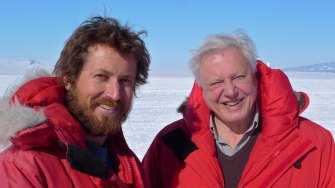 Hunter with Sir David Attenborough, in a frozen clime a world away from their time in Ethiopia.