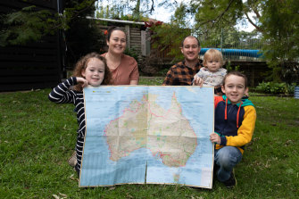 Amanda and Aaran Peggs with their three kids Ryan, Lily and Oliver at home in Wollongong.