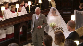 Meghan Markle walks down the aisle with Prince Charles.