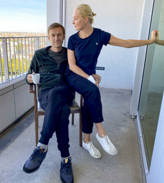 Navalny and his wife Yulia pose for a photo in a Berlin hospital