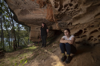 Gundungurra Traditional Owners Taylor Clarke (right) and her mother Kazan Brown visit a cave near the Coxs River, downstream from the junction with the Kowmung.