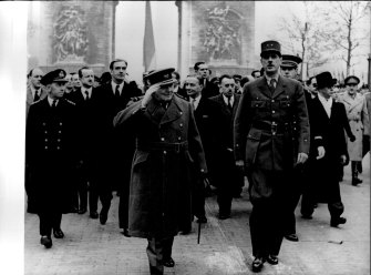 Winston Churchill and Charles De Gaulle walk down the Champs-Élysées after the liberation of Paris in 1944.