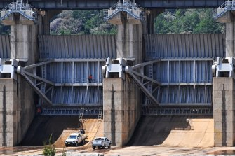 Work crews at the gates of Wyangala Dam: the business case for lifting the wall is yet to be made public.