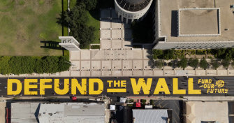 "An aerial shot of a new ""Defund The Wall"" mural that was painted outside the Laredo federal courthouse."