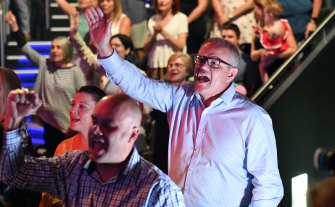 Scott Morrison sings during an Easter Sunday service at his Horizon Church at Sutherland.