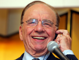 Rupert Murdoch smiles as he speaks at a press conference in Tokyo on November 6, 2006.