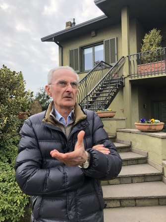 Luigi Malabarba outside his home on the edge of the quarantine zone in northern Italy.