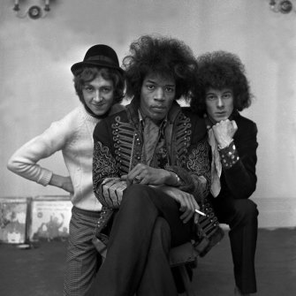 Jimi Hendrix in his iconic Hussar jacket with band members Mitch Mitchell and Noel Redding.