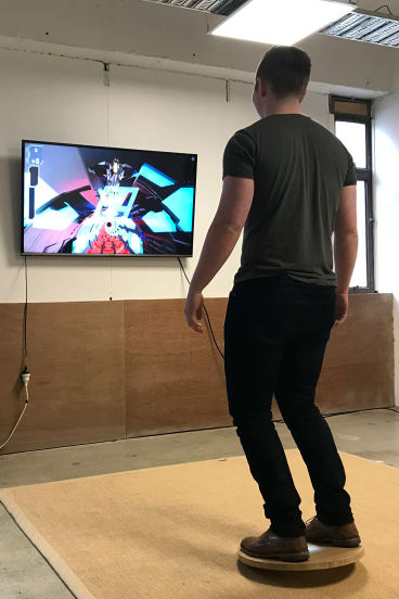 Swibo's Ben Dunn plays one of their video games.