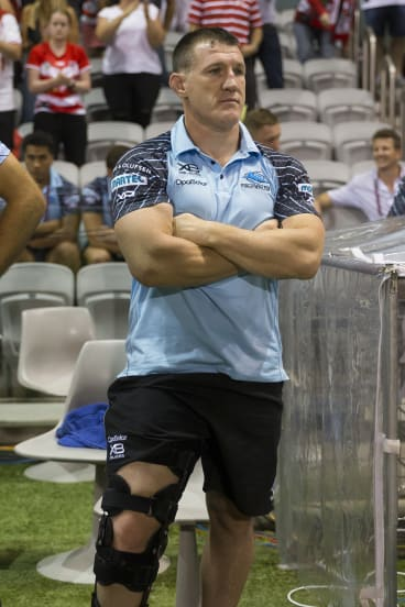 Gallen stands with his knee in a brace after being forced from the field.