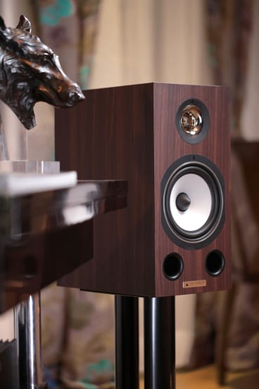 The speakers have a unique-looking tweeter and forward-facing bass reflex ports.