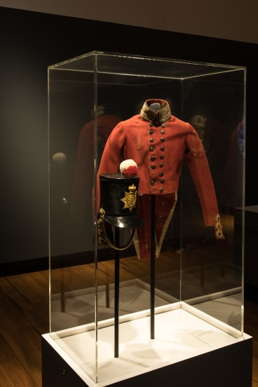 A British soldier's jacket from  Brisbane's convict settlement, at the Life in Irons exhibition at the Museum of Brisbane.