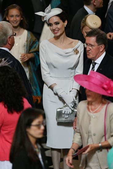 Channeling Meghan? Angelina Jolie attends a service marking the 200th anniversary of the Most Distinguished Order of St Michael and St George, at St. Paul's Cathedral in London.