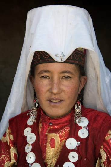 In the Pamir, married Kyrgyz women pin long white veils to their hats