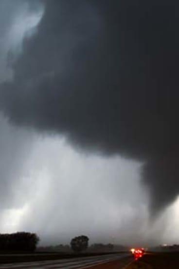 A tornado makes its way over the 135 freeway near Moundridge, Kansas.