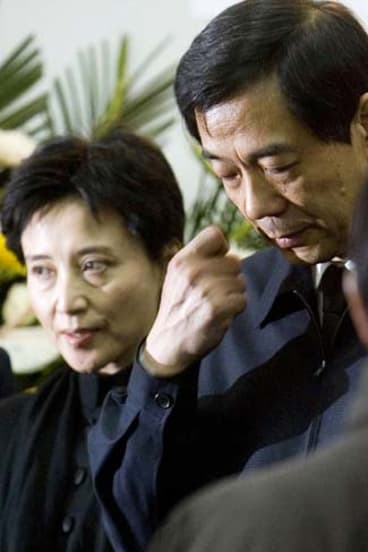 Spectacular fall ... Bo Xilai and his wife, Gu Kailai, attend his father's funeral in Beijing in January. Bo has since been stripped of positions, and his wife implicated in the murder of a British businessman.