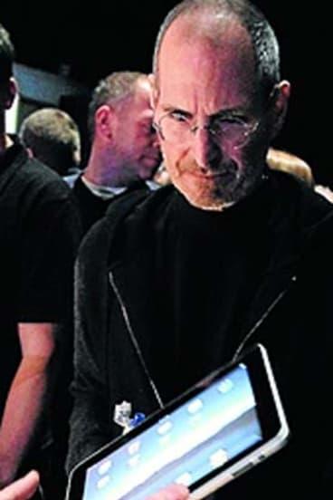 Apple's Steve Jobs with the original iPad.