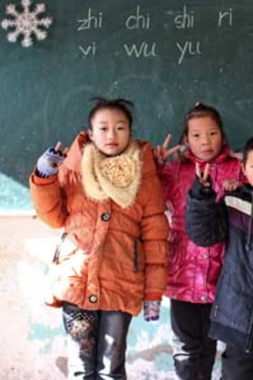 China: Pupils start the day at 7am - by saluting the flag - and finish at 8.30pm, after three hours of supervised homework.