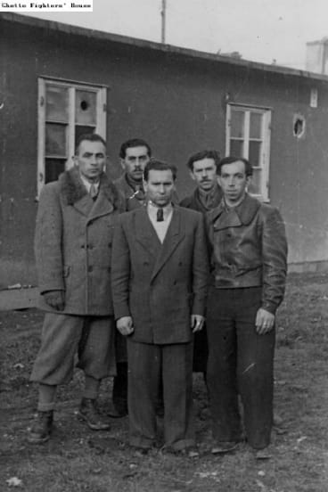 Mark Frydenberg's father Hersz, centre, with fellow survivors from his town in the displaced persons camp.