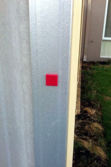 """A photo shared on social media is captioned: """"These red symbols are tags that people stealing Perth dogs are putting on your gates/fences. These tags identify which house has a dog that needs to be collected later that day/night."""""""
