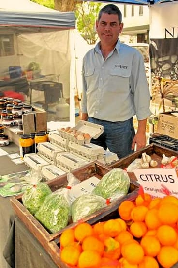 Trading post ... Andrew Hearne sells produce at the organic food market in Double Bay.