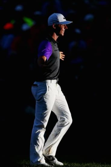 McIlroy salutes the crowd after he sank his final shot in the dark.