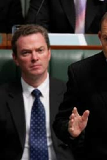 Opposition Leader Tony Abbott in Question Time flanked by his loyal backers.