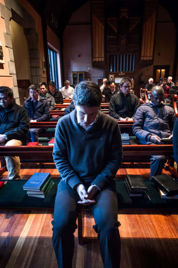 Catholic student priests at the Corpus Christi College during morning prayer.