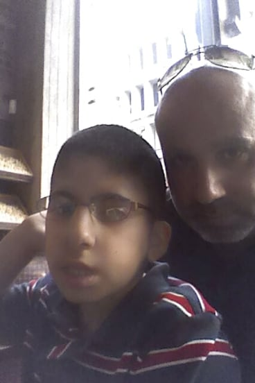 Mr Zahr with Mohamed Ali, 12. Both his children have myotonic dystrophy.