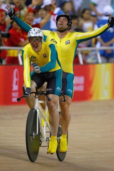 Gold rush: Kieran Modra raises his arms in triumph as he wins gold at the Beijing Paralympic Games.