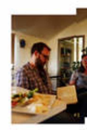 Blind faith … a group of Miller's followers talk to journalist Matt Siegel (far left).