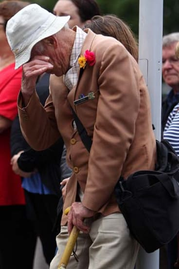 A Wellington man shows his emotion as New Zealand holds two minutes' silence at 12.51pm to mark the time of last week's Christchurch earthquake.