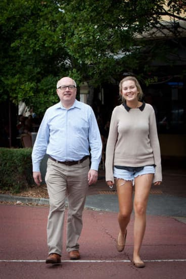 Family guy … George Brandis with his daughter Phoebe in Brisbane.