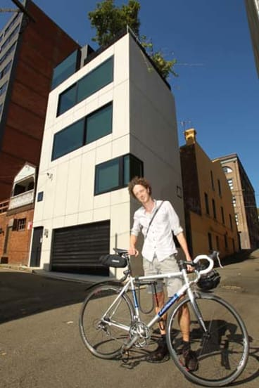 On your bike ... Eoghan Lewis from Sydney Architectural Walks at Domenic Alvaro's clever Surry Hills home.
