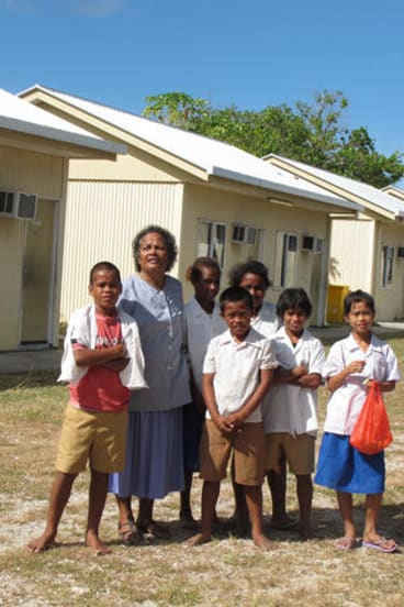 Nauru's new president still supports reopening detention centres. Principal Jocelyn Adam and students are pictured here at one decommissioned site.