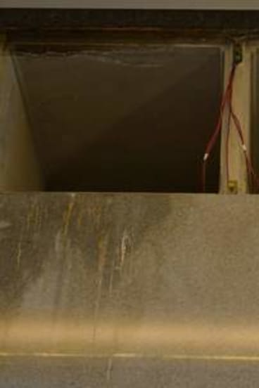Stained crypts and water damage in the mausoleum.