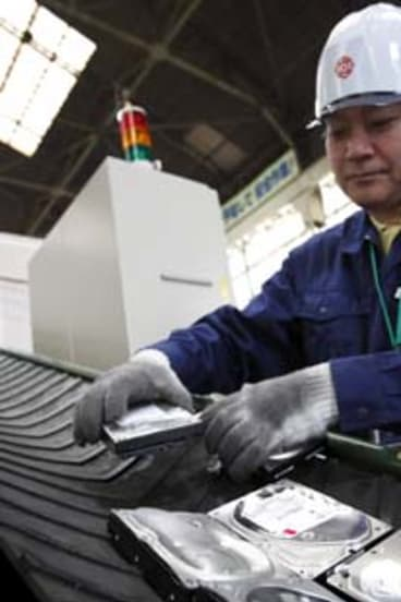 Recycling rare earth magnets inside hard drives in Matsudo, Japan.
