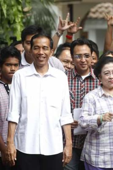 No walk in the park: Jokowi with former Indonesian president Megawati Sukarnoputri in 2012. His support has recently dipped, although he remains the favourite to win the presidency.