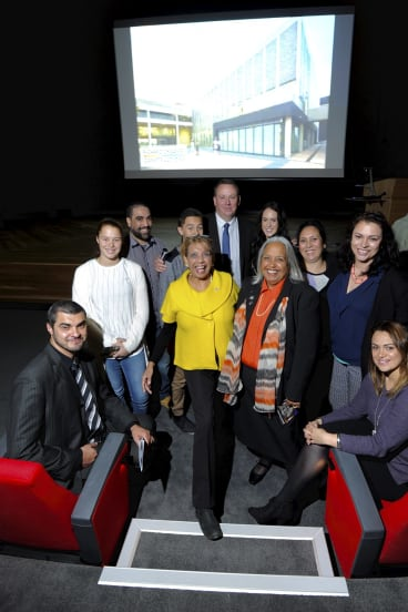 Reg Saunders' daughters, Dorothy Burton, (centre left with yellow coat)  and Glenda Humes (with scarf), along with extended family at the opening of the Captain Reginald Saunders Theatre on Wednesday.