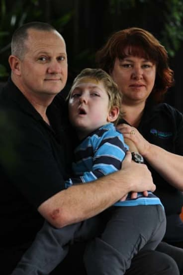 Brain damaged ... Michael and Jo-ann Morris with Samuel, who fell into a pool.