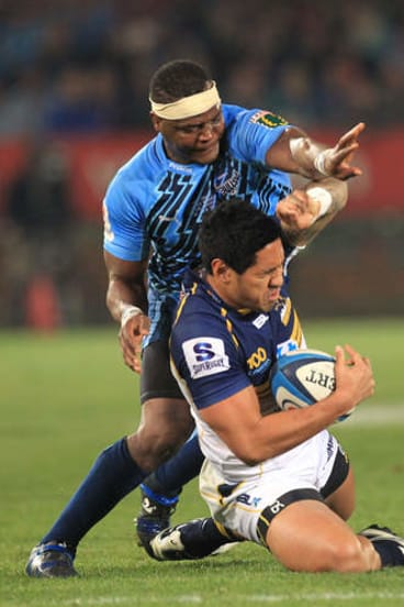 Brumbies winger Joe Tomane cleans up possession.